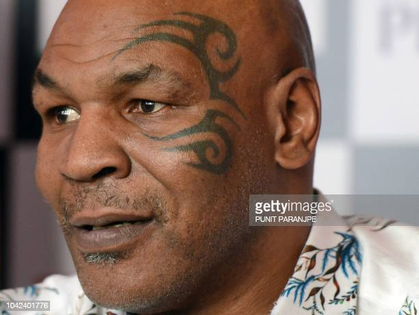 Former US boxer Mike Tyson speaks during a news conference to announce India's first global mixed martial arts Kumite 1 league in Mumbai on September...