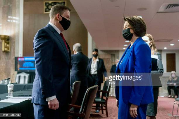 Former U.S. Capitol Police Chief Steven Sund and Chairwoman Senator Amy Klobuchar speak before the start of a Senate Homeland Security and...