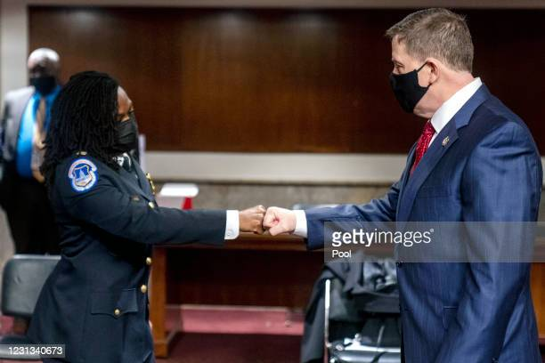 Former U.S. Capitol Police Chief Steven Sund greets Capitol Police Captain Carneysha Mendoza before they testify before a Senate Homeland Security...