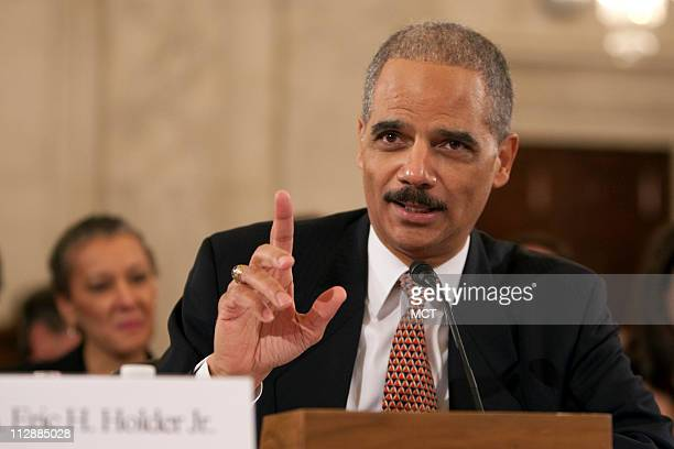 Former U.S. Deputy Attorney General Eric Holder, President-elect Barack Obama's nominee to be Attorney General, makes opening remarks at his...
