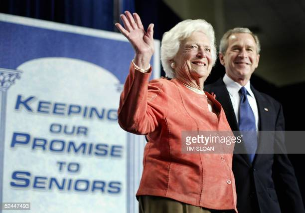 Former US first lady Barbara Bush waves after being introduced by her son US President George W. Bush at a meeting to promote his Social Security...