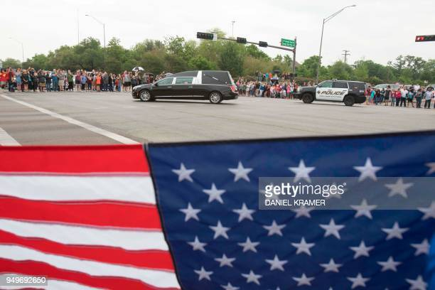 Former US First Lady Barbara Bush's funeral motorcade makes a turn onto George Bush Dr in College Station on April 21 2018
