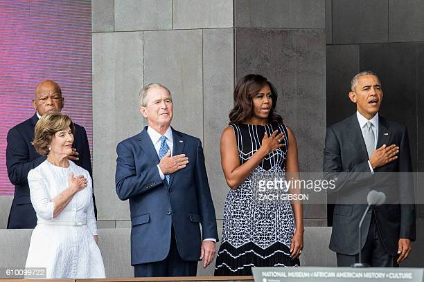 Former US First Lady Laura Bush former US President George W Bush First Lady Michelle Obama and President Barack Obama stand for the The National...