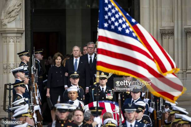 Former U.S. First Lady Laura Bush, from left, former U.S. President George W. Bush, and Jeb Bush, former Governor of Florida, exit as joint services...