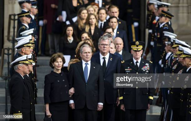 Former U.S. First Lady Laura Bush, from left, former U.S. President George W. Bush, and Jeb Bush, former Governor of Florida, watch as joint services...