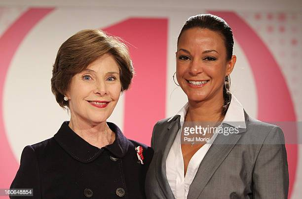 Former US first lady Laura Bush poses for a photo with actress Eva LaRue at the 2013 Susan G Komen Global Women's Cancer Summit at Fairmont Hotel on...