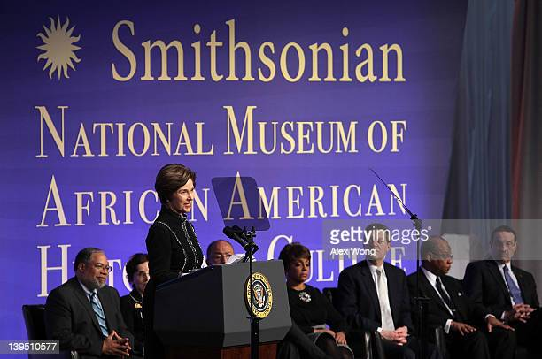 Former US first lady Laura Bush speaks as museum director Lonnie Bunch chair of Smithsonian Board of Regents France Cordova cochair of National...