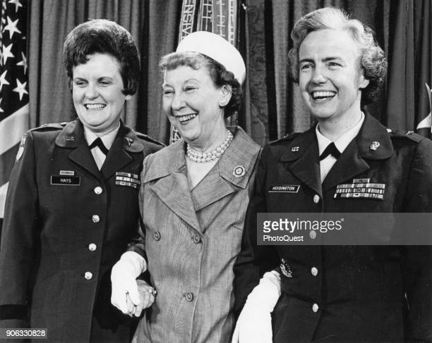 Former US First Lady Mamie Eisenhower poses with the US Army's Brigadier General Anna Mae Hays and Brigadier General Elizabeth Hoisington at the...