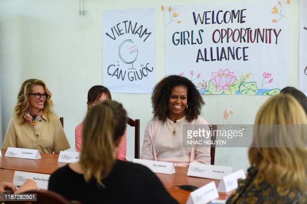 Former US First Lady Michelle Obama and actress Julia Roberts meet Vietnamese students in Can Giuoc district, Long An province on December 9, 2019. -...