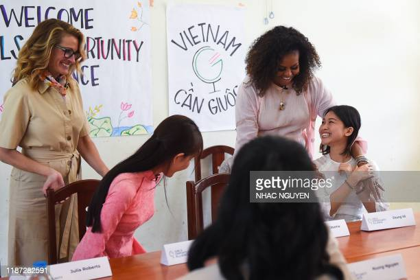 Former US First Lady Michelle Obama and actress Julia Roberts meet Vietnamese students in Can Giuoc district, Long An province on December 9, 2019 -...