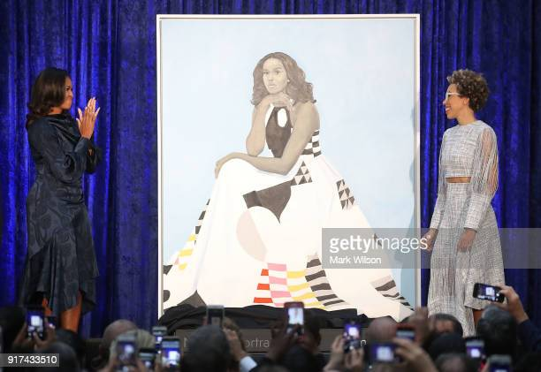 Former US first lady Michelle Obama and artist Amy Sherald unveil her portrait during a ceremony at the Smithsonian's National Portrait Gallery on...