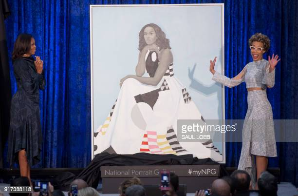 TOPSHOT Former US First Lady Michelle Obama and artist Amy Sherald unveil Mrs Obama's portrait at the Smithsonian's National Portrait Gallery in...