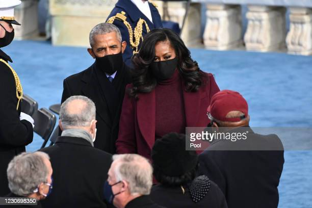 Former US First Lady Michelle Obama and former US President Barack Obama arrive for the 59th Presidential Inauguration at the U.S. Capitol on January...