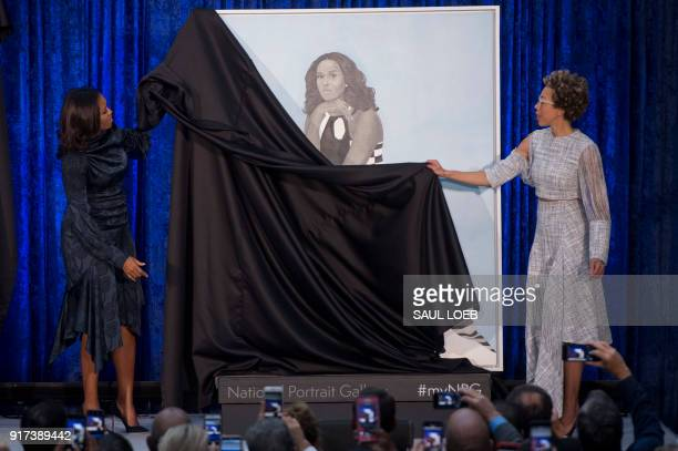 Former US First Lady Michelle Obama and her portrait's artist Amy Sherald unveil her portrait at the Smithsonian's National Portrait Gallery in...