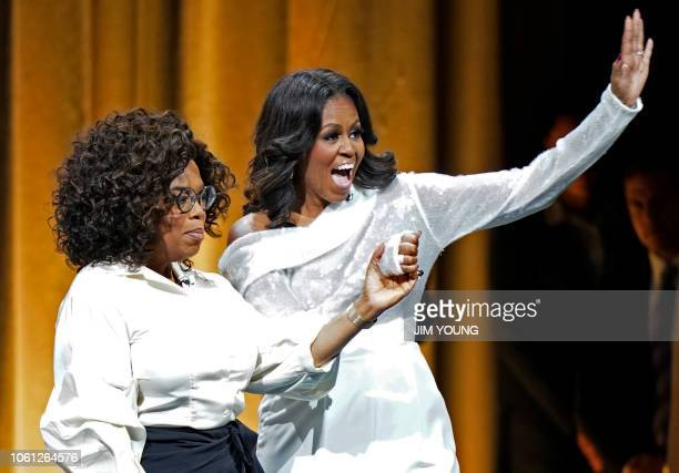 Former US first lady Michelle Obama and Oprah Winfrey attend the opening of Obama's multicity book tour at the United Center in Chicago on November...
