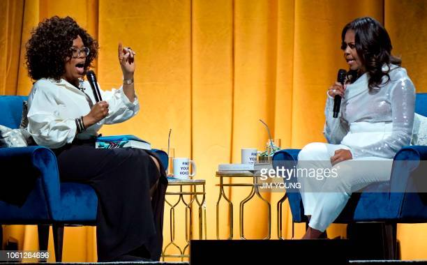Former US first lady Michelle Obama and Oprah Winfrey speak during the opening of Obama's multicity book tour at the United Center in Chicago on...