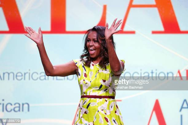 Former US first lady Michelle Obama waves after discussing her forthcoming memoir with Dr Carla Hayden the 14th Librarian of Congress titled...