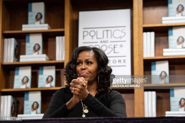 """Former US first lady Michelle Obama meets with fans during a book signing on the first anniversary of the launch of her memoir """"Becoming"""" at the..."""