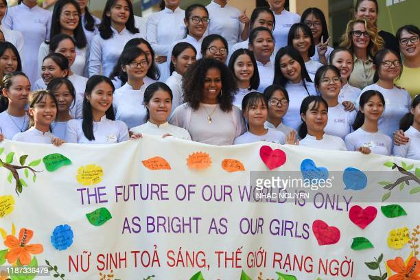 Former US First Lady Michelle Obama poses for picture with Vietnamese students in Can Giuoc district, Long An province on December 9, 2019. -...