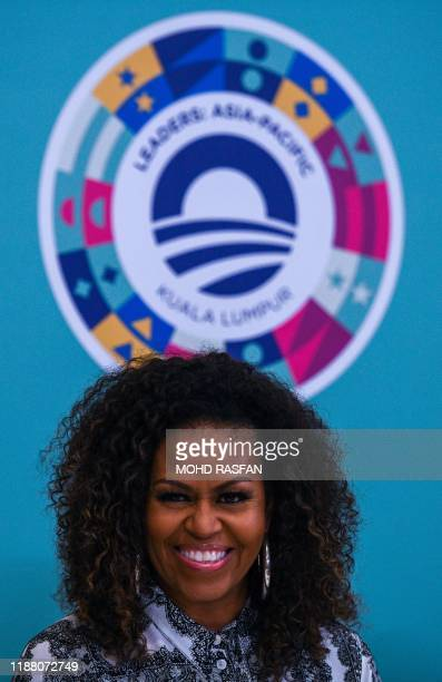 Former US first lady Michelle Obama smiles as she attends a side event for the Obama Foundation in Kuala Lumpur on December 12, 2019.