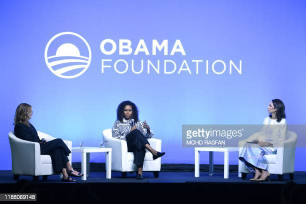 Former US first lady Michelle Obama speaks as US actress Julia Roberts listens as they attend an event for the Obama Foundation in Kuala Lumpur on...