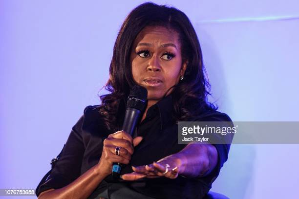Former US First Lady Michelle Obama speaks at an event at the Elizabeth Garrett Anderson School on December 03 2018 in London England The former...