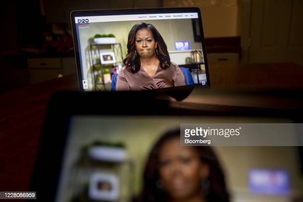 Former U.S. First Lady Michelle Obama speaks during the virtual Democratic National Convention seen on a laptop computer in Tiskilwa, Illinois, U.S.,...