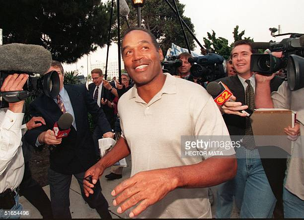 Former US football star O.J. Simpson arrives at the courthouse in Santa Monica, CA, 15 May to answer questions about his assets after failing to...