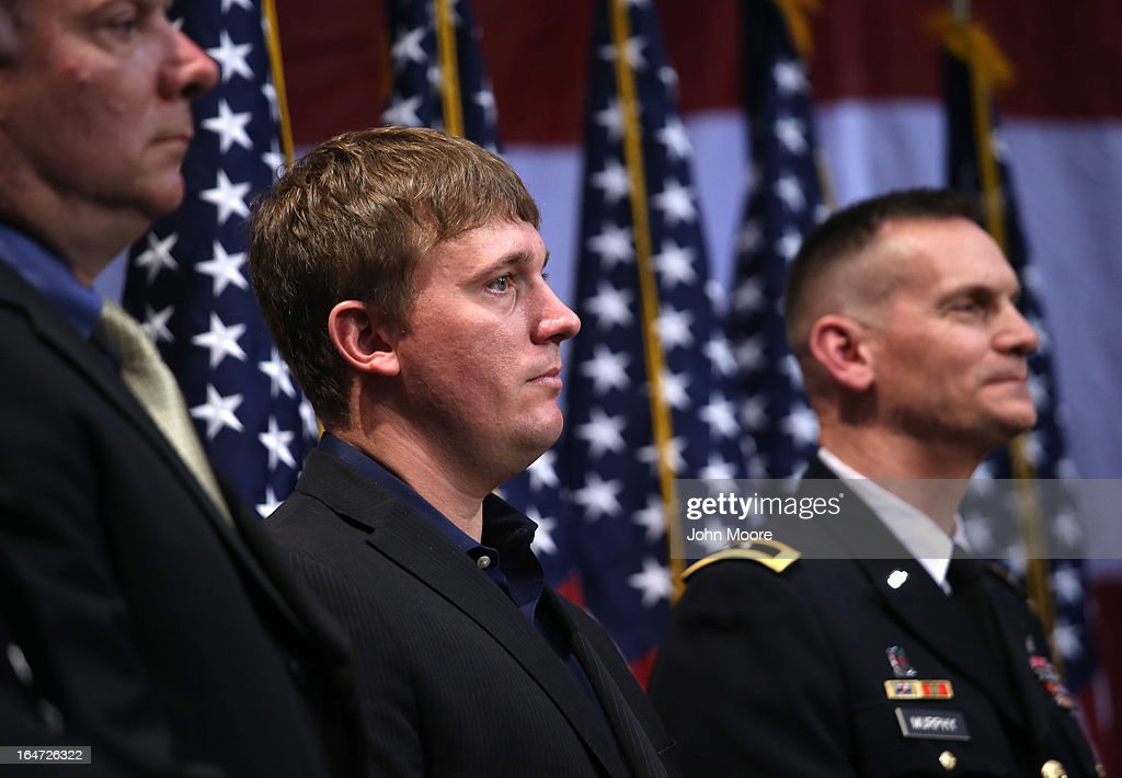 Former U.S. Marine and Medal of Honor recipient Dakota Meyer (C) stands after speaking at the Hiring Our Heroes job fair held on March 27, 2013 in New York City. Hundreds of veterans and their spouses turned out to meet more than 100 employers participating at the second annual event, hosted by the U.S. Chamber of Commerce National Chamber Foundation. Lead sponsors were Capital One Financial Corporation and Toyota.