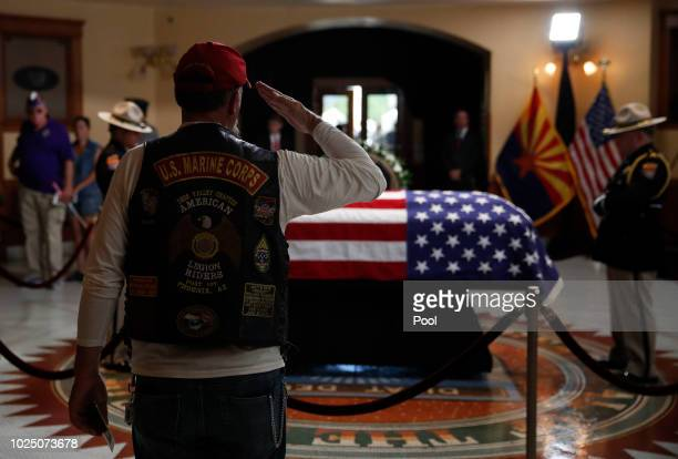 Former U.S. Marine salutes near the casket during a memorial service at the Arizona Capitol on August 29 in Phoenix, Arizona. Sen. McCain, a...