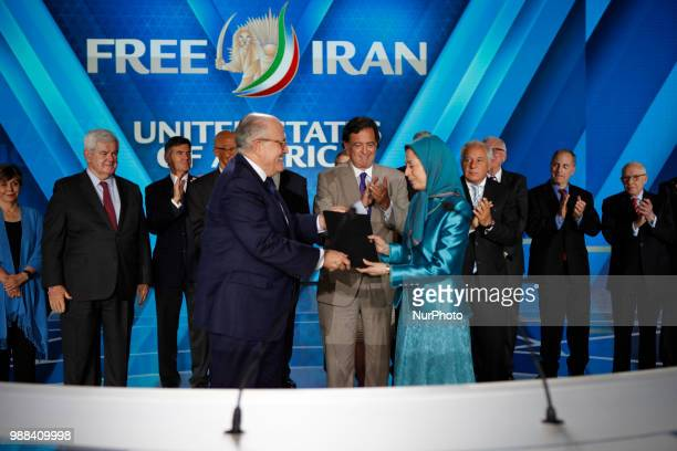 Former US mayor of New York Rudy Giuliani with Iran's opposition leader Maryam Rajavi as the pose with Statement by 33 Former Senior US Officials amp...