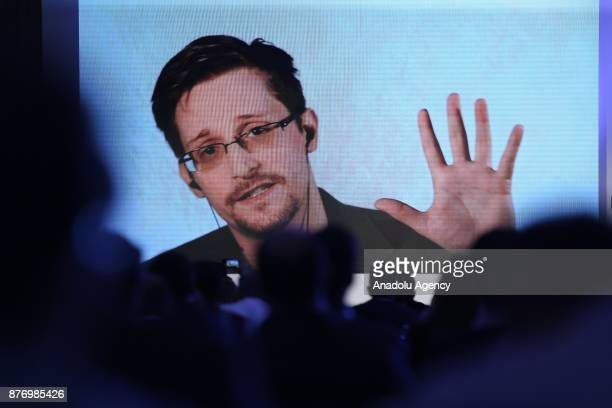 Former US National Security Agency contractor Edward Snowden delivers a speech by a video conference during a session titled 'How to solve the next...