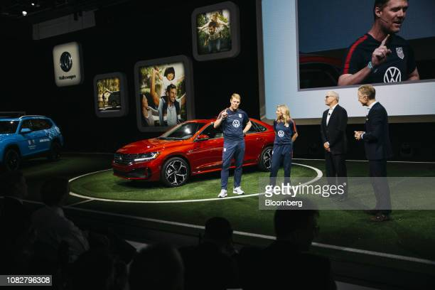 Former US National Soccer League players Alexi Lalas from left and Aly Wagner stand with Scott Keogh chief executive officer of Volkswagen Group of...