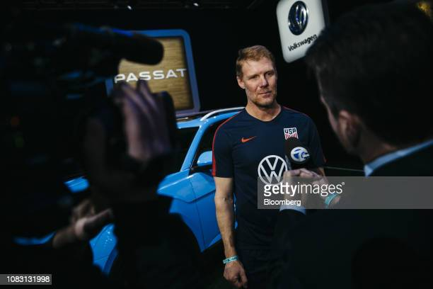 Former US National Soccer League players Alexi Lalas speaks to members of the media during the Volkswagen AG 2020 Passat sedan reveal at the 2019...