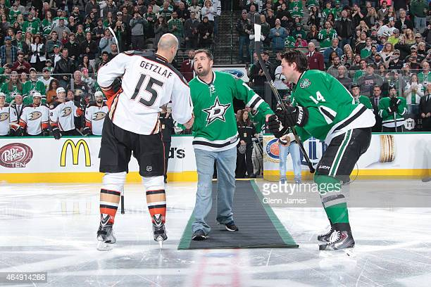 Former US Navy Seal Marcus Luttrell drops the ceremonial first puck as part of Military Appreciation night between Ryan Getzlaf of the Anaheim Ducks...