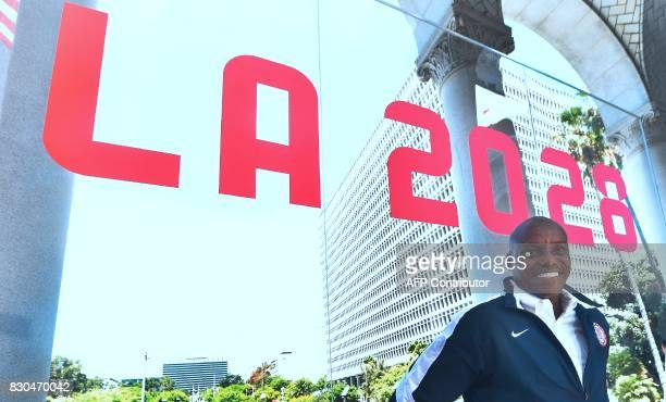 Former US Olympian Carl Lewis poses following a news conference outside City Hall by Los Angeles after the Los Angeles City Council's vote on the...