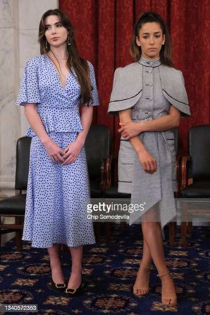 Former U.S. Olympic gymnasts Aly Raisman and McKayla Maroney participate in a news conference in the Russell Senate Office Building after testifying...