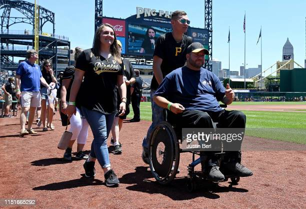 Former US paralympian Kevin Polish takes part in a pregame ceremony before the game between the Pittsburgh Pirates and the San Diego Padres at PNC...