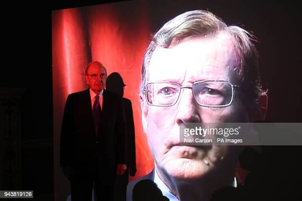 Former US peace envoy to Northern Ireland George Mitchell views a projection of Former Ulster Unionist Leader David Trimble during an exhibition...