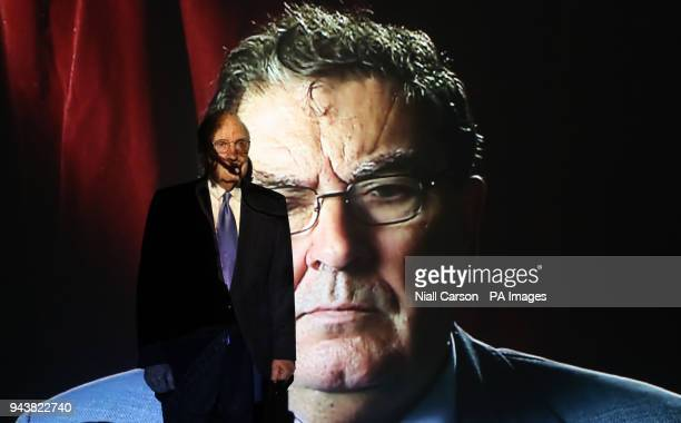 Former US peace envoy to Northern Ireland George Mitchell views a projection of former SDLP Leader John Hume during an exhibition entitled The Keeper...