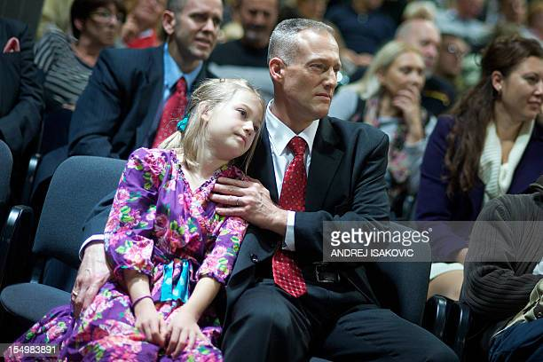 """Former US pilot Dale Zelko and his daughter wait for the premiere of the documentary """"Second Meeting"""" in Belgrade on October 29, 2012. A US pilot and..."""