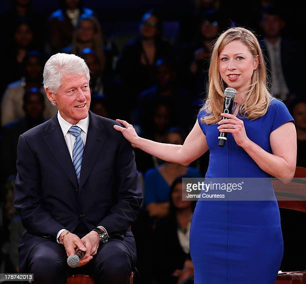 Former US President and founder of the Clinton Foundation Bill Clinton appears onstage with daughter Chelsea Clinton during the Embrace Tomorrow A...