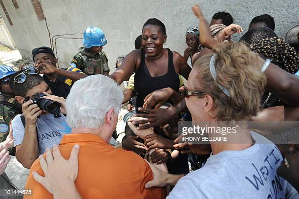 Former US president and special UN representative for Haiti Bill Clinton visits a construction project of small houses on June 1 2010 in Leogane 33...