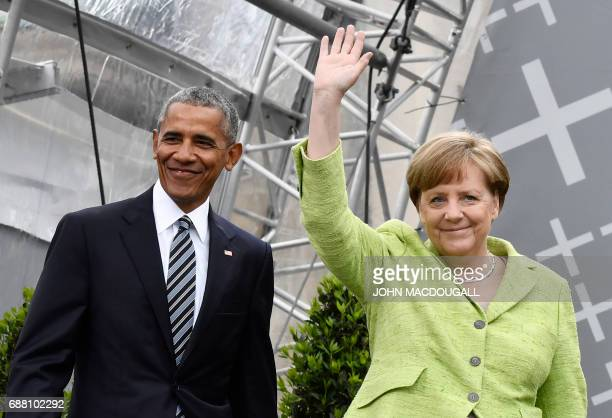 Former US president Barack Obama and Chancellor Angela Merkel arrive on stage during the Protestant church day event at the Brandenburg Gate in...