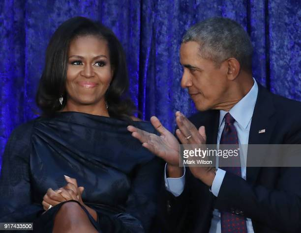 Former US President Barack Obama and first lady Michelle Obama participate in the unveiling of their official portraits during a ceremony at the...