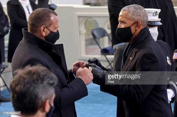 Former U.S. President Barack Obama and former baseball player Alex Rodriguez greet each other at the inauguration of President-elect Joe Biden on the...