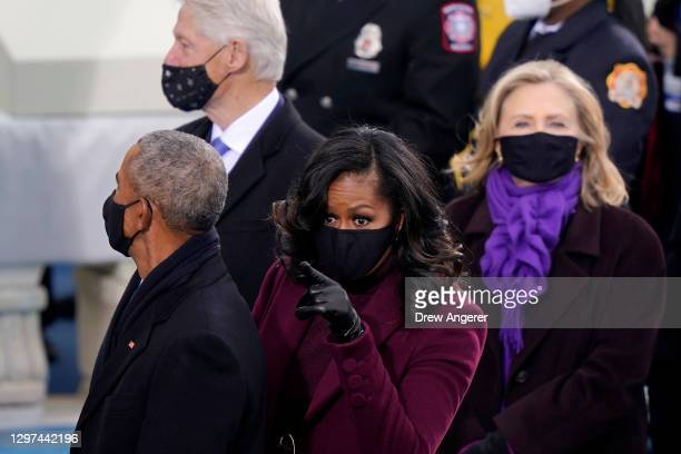 Former U.S. President Barack Obama and former first lady Michelle Obama arrive to the inauguration of U.S. President-elect Joe Biden on the West...