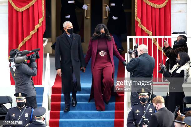 Former U.S. President Barack Obama and former first lady Michelle Obama arrive at the inauguration of U.S. President-elect Joe Biden on the West...
