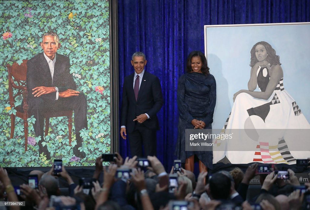 Former U.S. President Barack Obama and former first lady Michelle Obama stand next to their newly unveiled portraits during a ceremony at the Smithsonian's National Portrait Gallery, on February 12, 2018 in Washington, DC. The portraits were commissioned by the Gallery, for Kehinde Wiley to create President Obama's portrait, and Amy Sherald that of Michelle Obama.