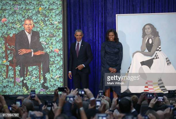 Former US President Barack Obama and former first lady Michelle Obama stand next to their newly unveiled portraits during a ceremony at the...